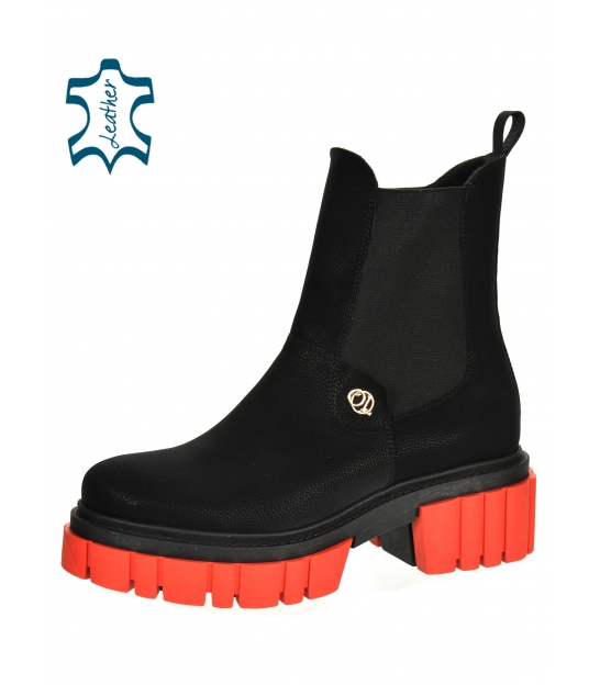 Black ankle boots on a red sole 2302